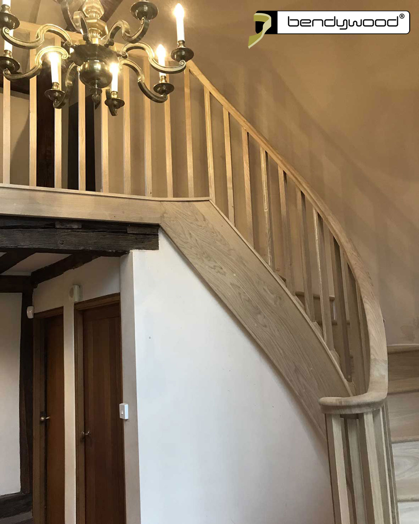 Customized staircase with banister in Bendywood®-oak.